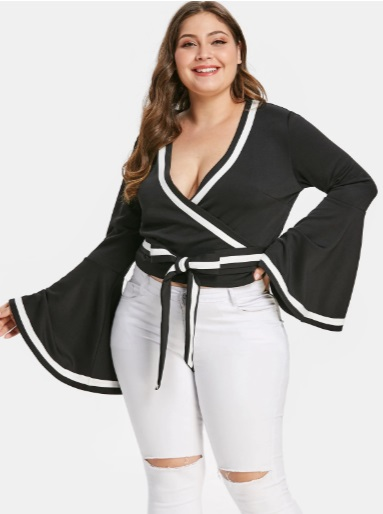 most appealing color combination of black blouse paired with white jeans