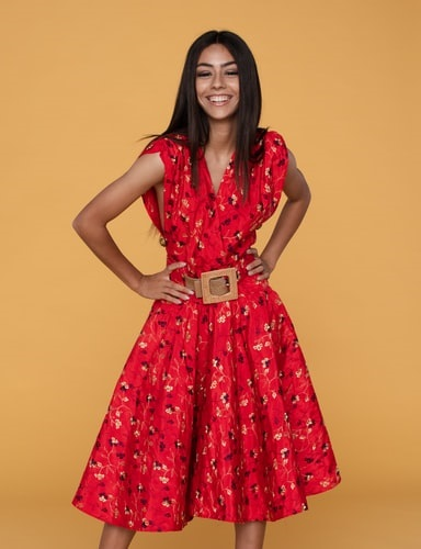happy lady matching her red dress with her favorite belt
