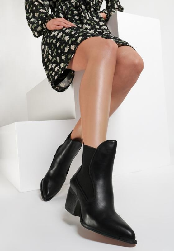 leather black boots accessory is a match with black casual dress