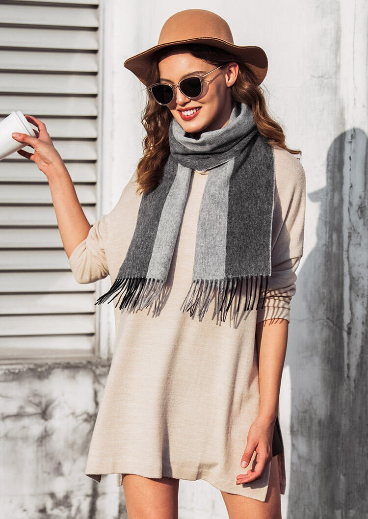 looking versatile lady in her silk scarf and hat accessories with elegant outfit