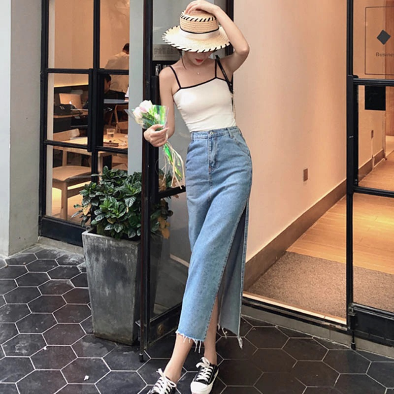 awesome look in Long straight skirt with side slits paired with sneakers